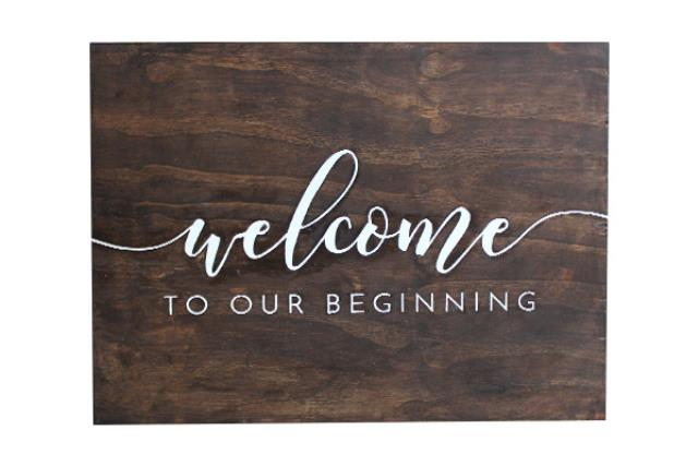WOODEN 'WELCOME TO OUR BEGINNING' SIGN